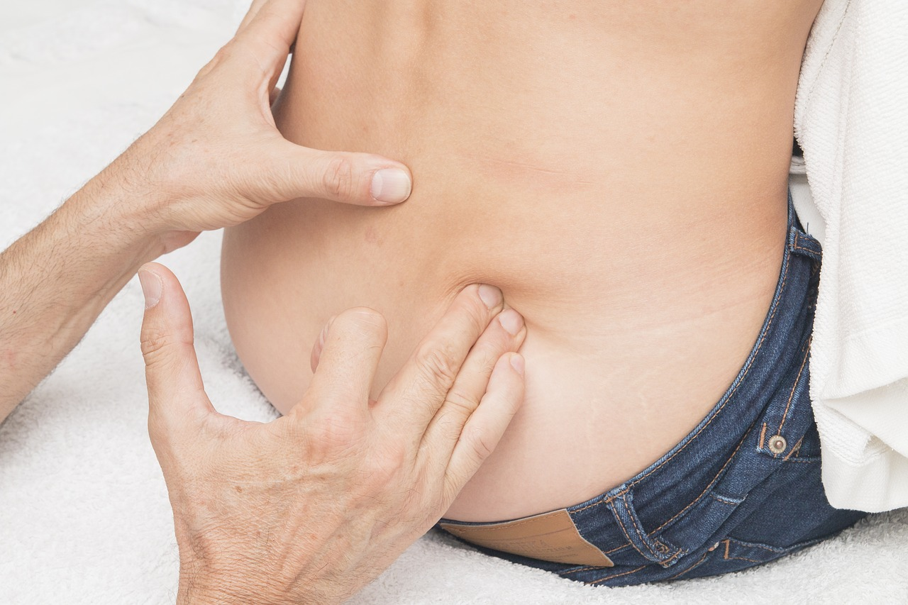 風邪の症状の腹痛と腰痛について。どうして起こる?対処法は?